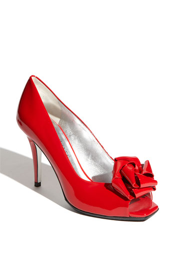 redweddingshoes Adding a little color to your wedding can be done in a