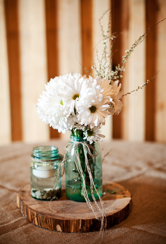 Rustic Wedding Centerpiece from our wedding (Navy blue) mason jars filled with baby's breath, votives, and moss, on wood slices for a diy cute centerpiece. Black Fox Farms Cleveland Tennessee wedding Photo by: Gloria Adele Photography Find this Pin and more .