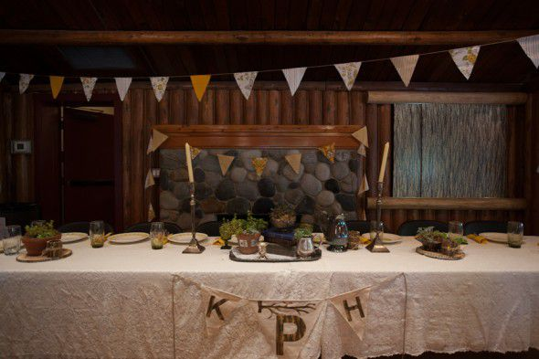 A rustic head wedding table at a lodge style wedding