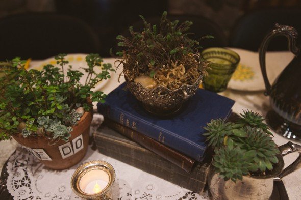 Centerpieces at a woodsy rustic chic wedding