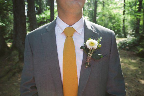 A yellow wedding tie at a rustic style wedding