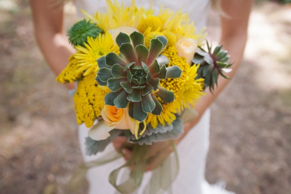 Bright yellow wedding bouquet at a woodsy rustic wedding