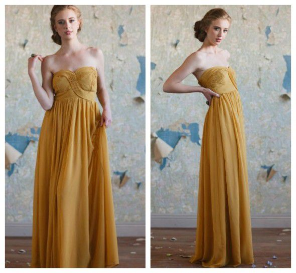 A gold long bridesmaid dress for a rustic or vintage style wedding