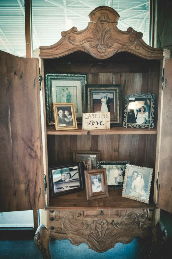 A bookcase is used as a display item at a wedding