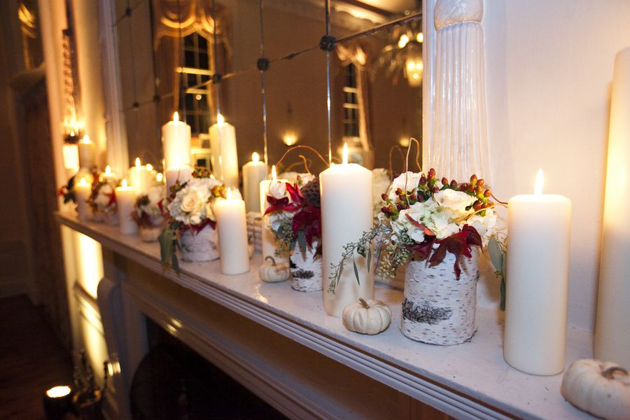 Birch vases and candles decorate a fall wedding