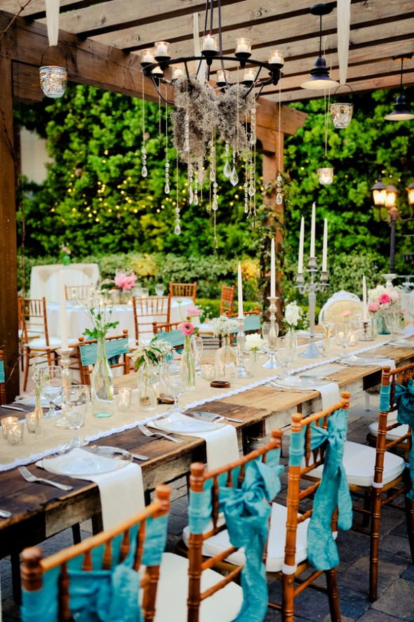 Long farm style tables at wedding