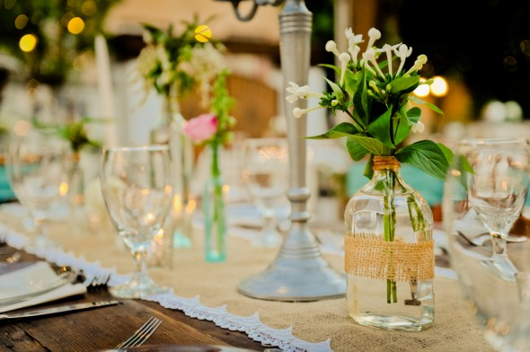 centerpieces using old bottles at a vintage wedding