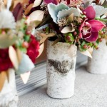 Rustic wedding flowers in birch vases