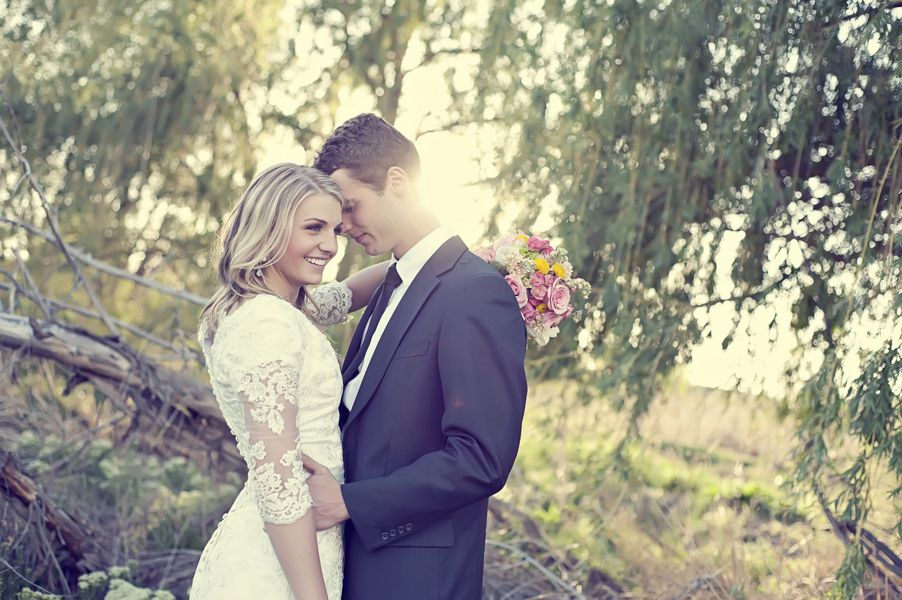 A rustic bride and groom in the woods