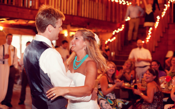 Bride and groom dancing at rustic wedding