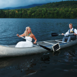 A bride and groom in a canoe