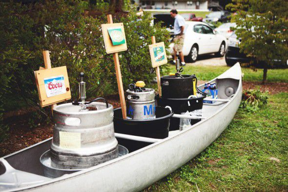 A canoe filled with drinks at a wedding