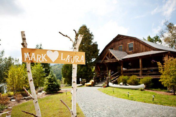 A rustic camp wedding with a birch sign