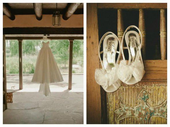 A rustic wedding gown hangs in a barn