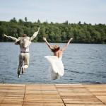 Bride & Groom Jumping In Lake
