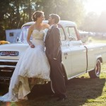 Bride and groom with pickup truck