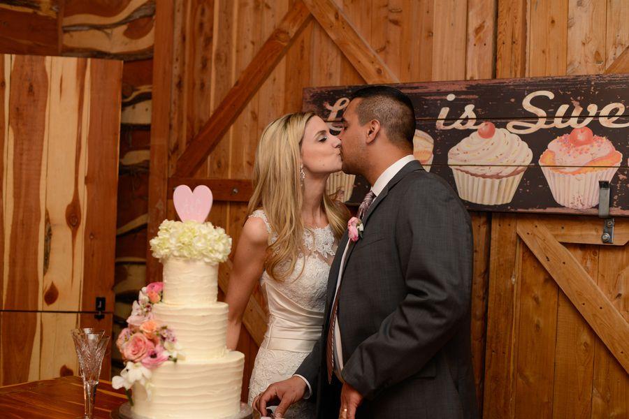 Texas ranch wedding cutting the cake