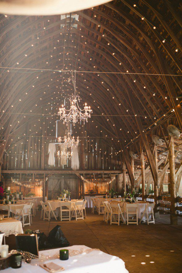 How to light a barn wedding rustic wedding chic chandelier in barn wedding mozeypictures Gallery