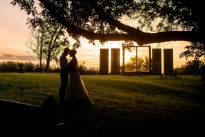 Bride and Groom as the Sun Sets on a Backyard Wedding