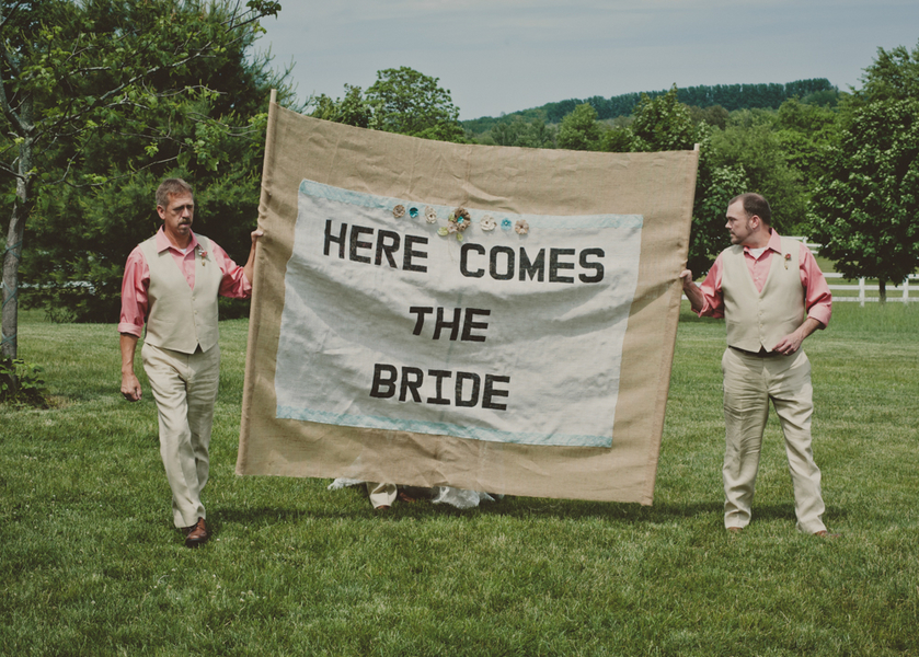 Here Come the Bride Burlap Sign Leads the Ceremony