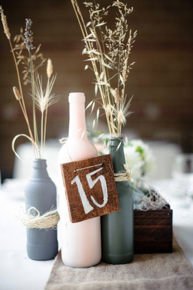 15 ways to decorate your wedding with wine bottles for Painted wine bottle wedding centerpieces