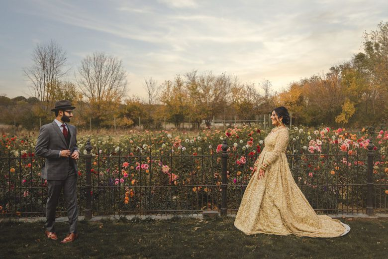 Bride and groom in field for first look before wedding