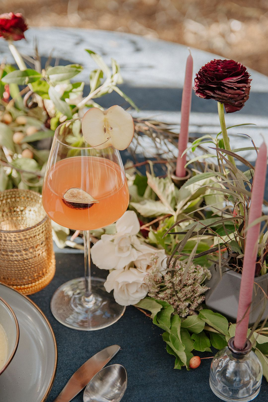 Wedding tablescape with drinks, flowers, and candles
