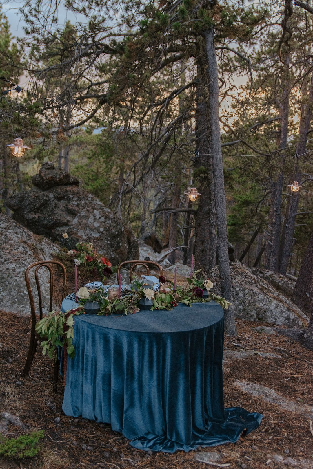 Wedding sweetheart table in the forest