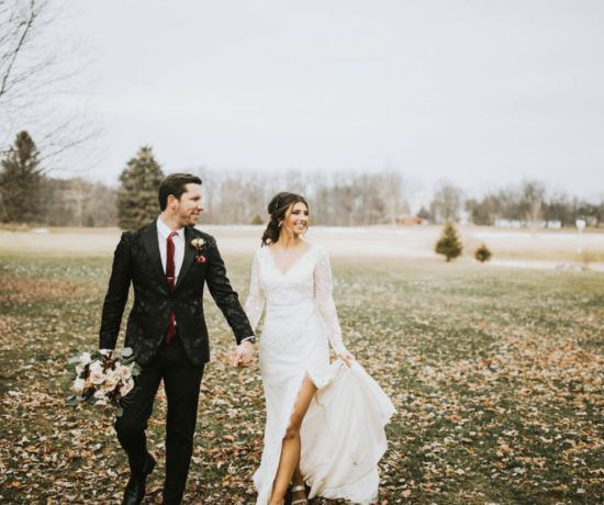 Bride and Groom holding hands at wedding venue
