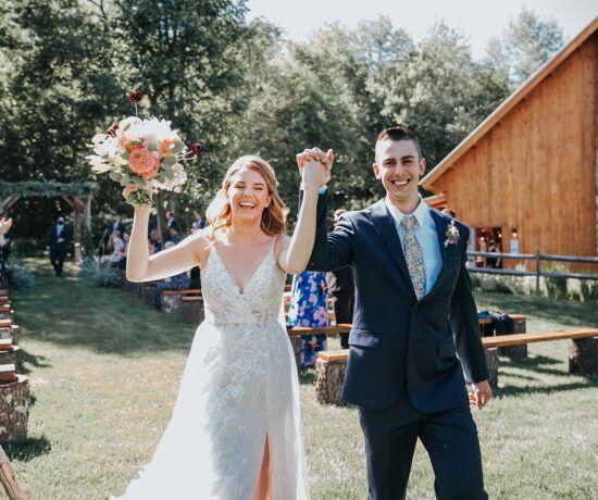 bride and groom smiling holding hands after wedding ceremony