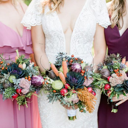 bride and bridesmaids holding bouquets made from vegetables