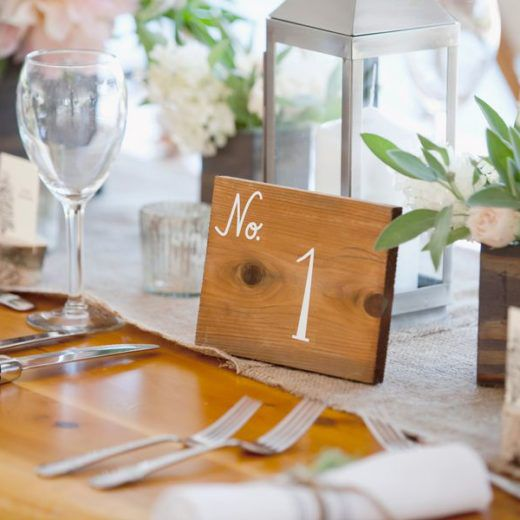 table number 1 written on wooden sign