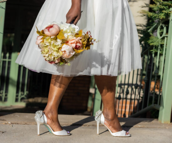 bride wearing sparkly wedding shoes
