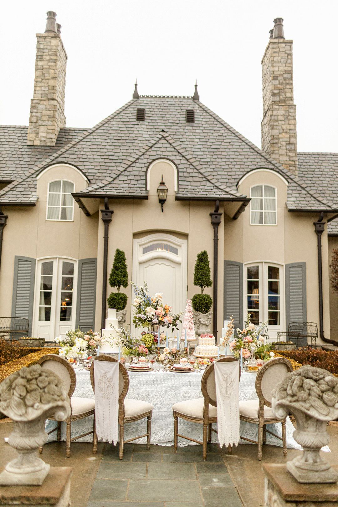 mansion with dessert table in front