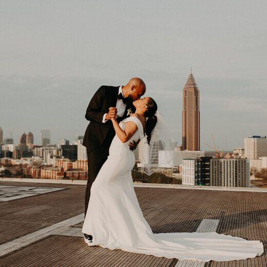 bride and groom dancing on rooftop