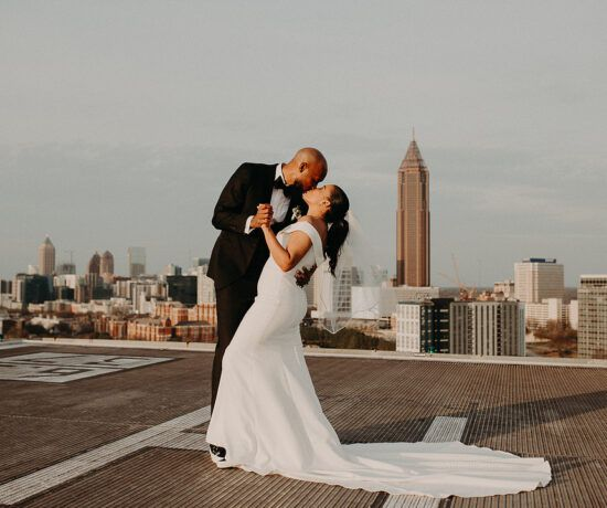 bride and groom dancing on rooftop
