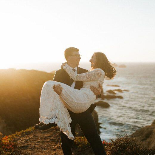 groom carrying bride atBig Sur Redwoods Elopement