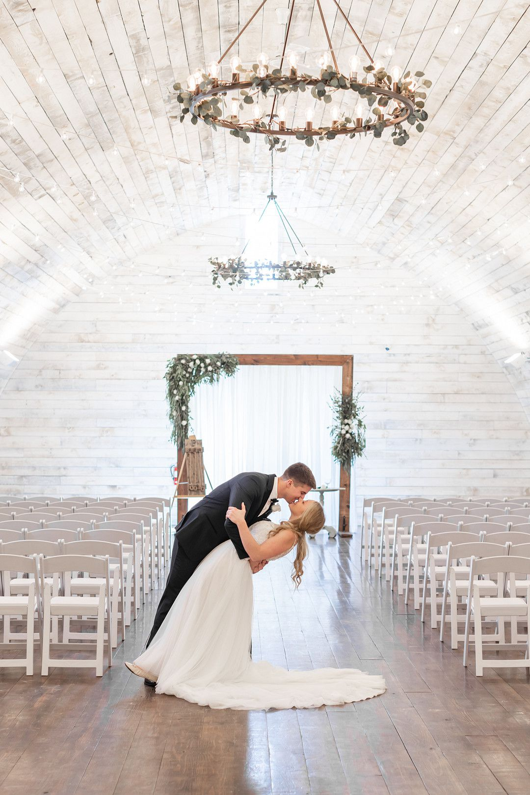 bride and groom kissing at winter wedding