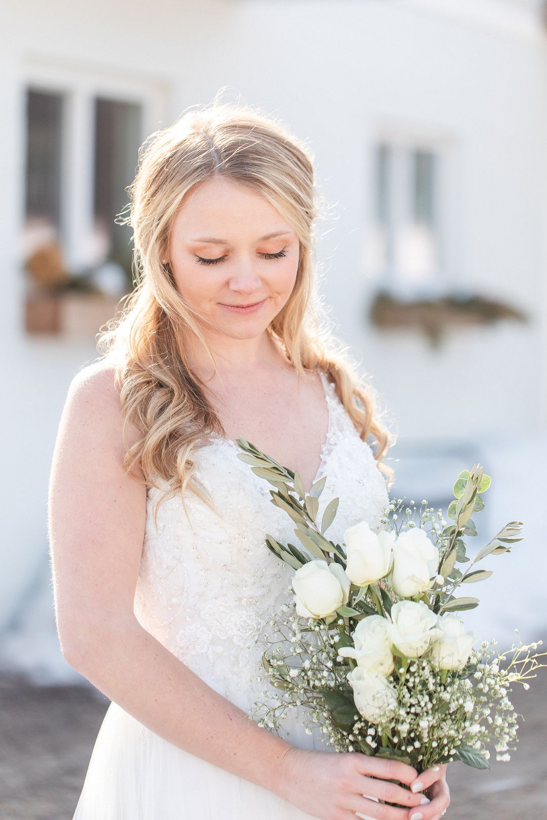upclose image of bride holding flowers