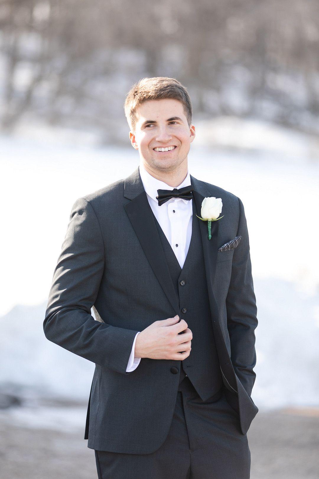 groom in tux outside