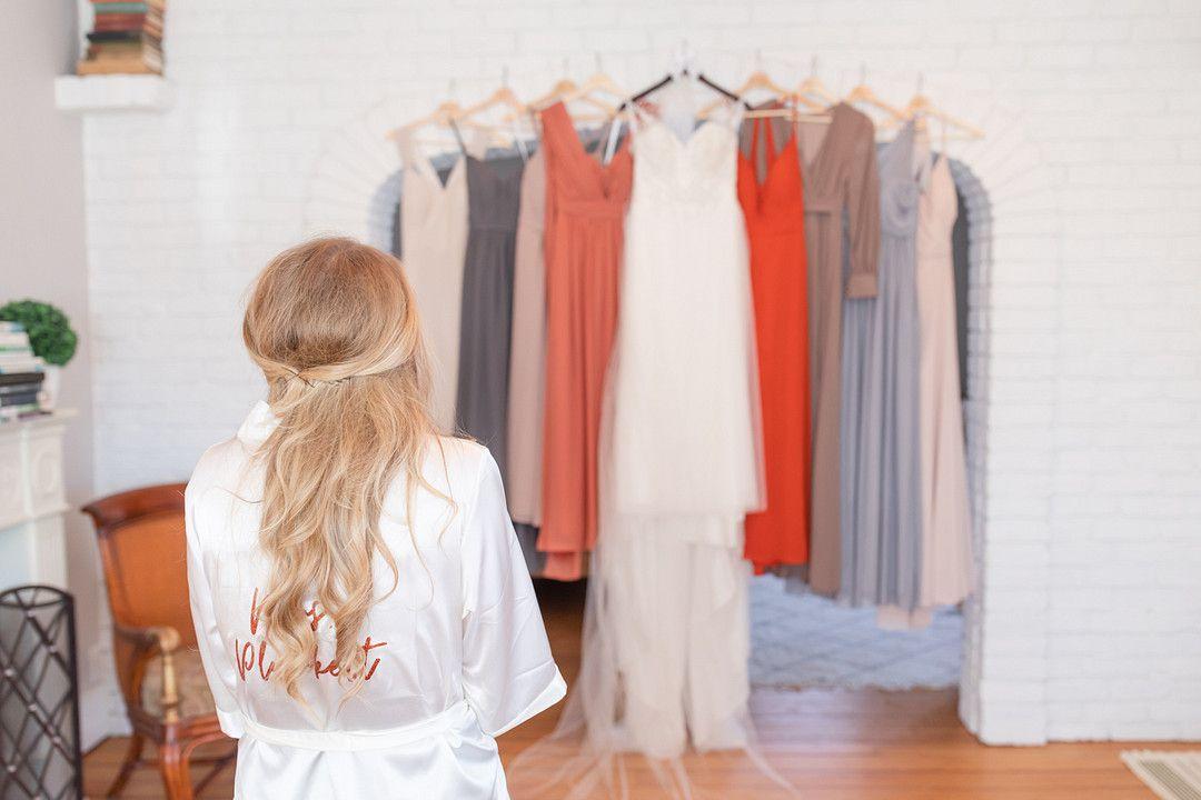 bride looking at bridesmaid dresses and wedding dress