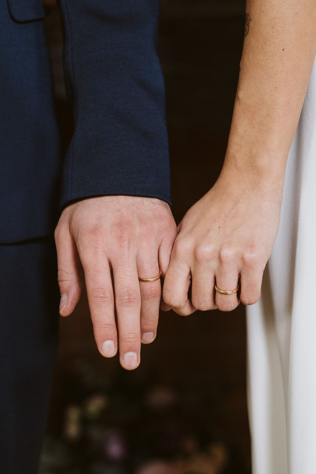bride and grooms hands with rings on