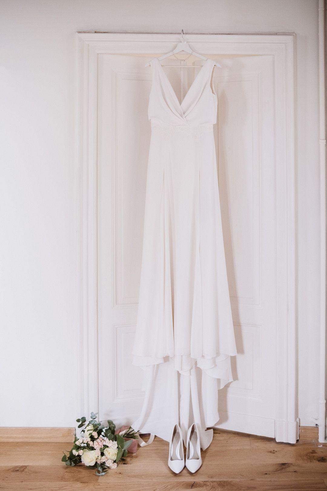 wedding dress hanging in from of bedroom door