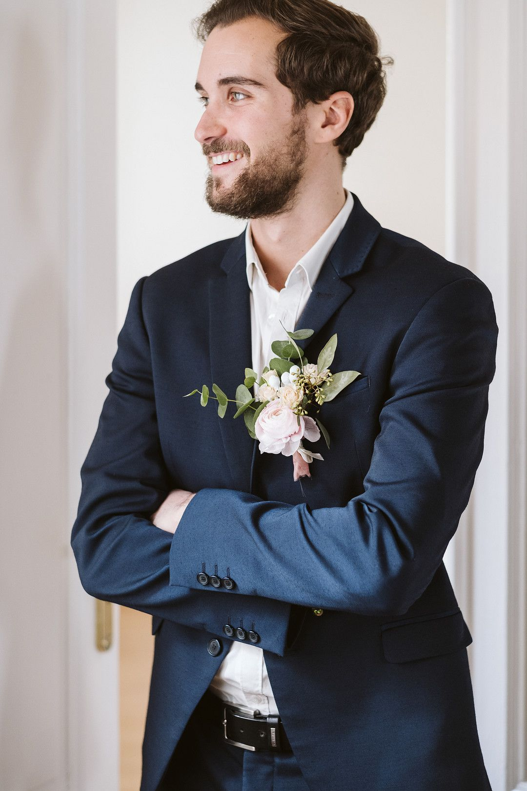 groom in suit at at home elopement