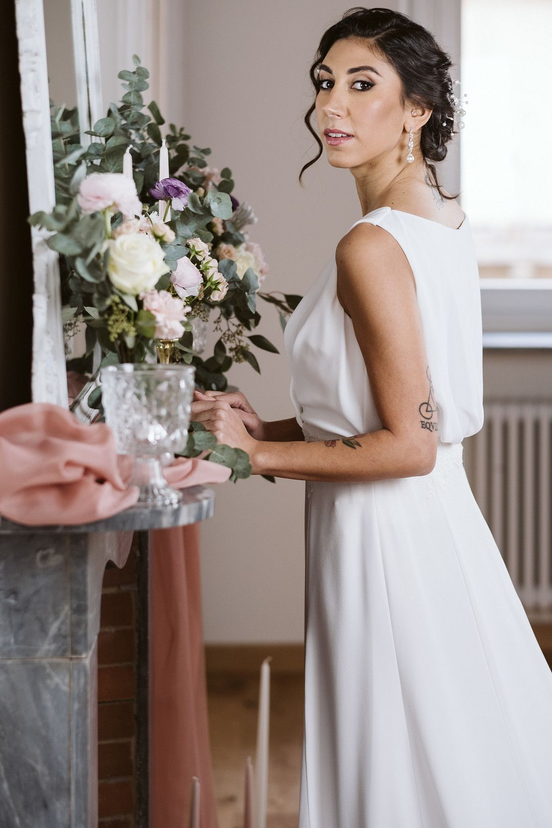 bride standing in front of fire place at at at home elopement