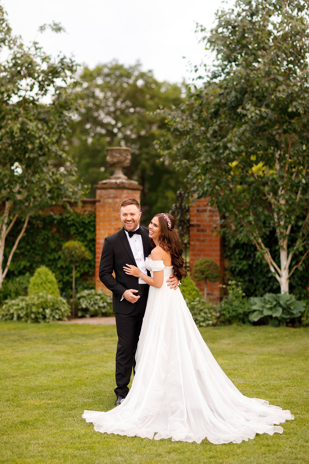 bride and groom at elegant summer wedding smiling and laughing