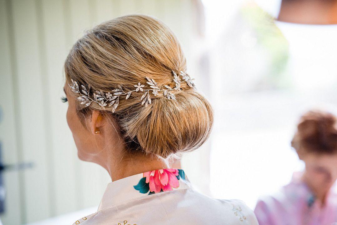low wedding bun with crystal headpiece