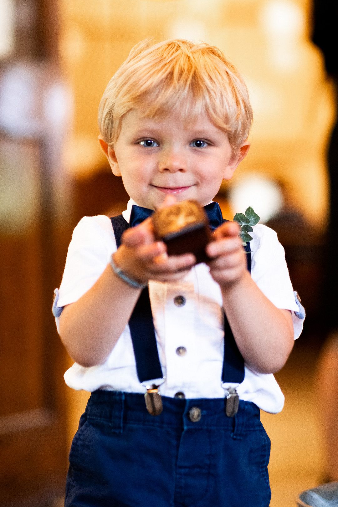 young ring bearer holding ring box