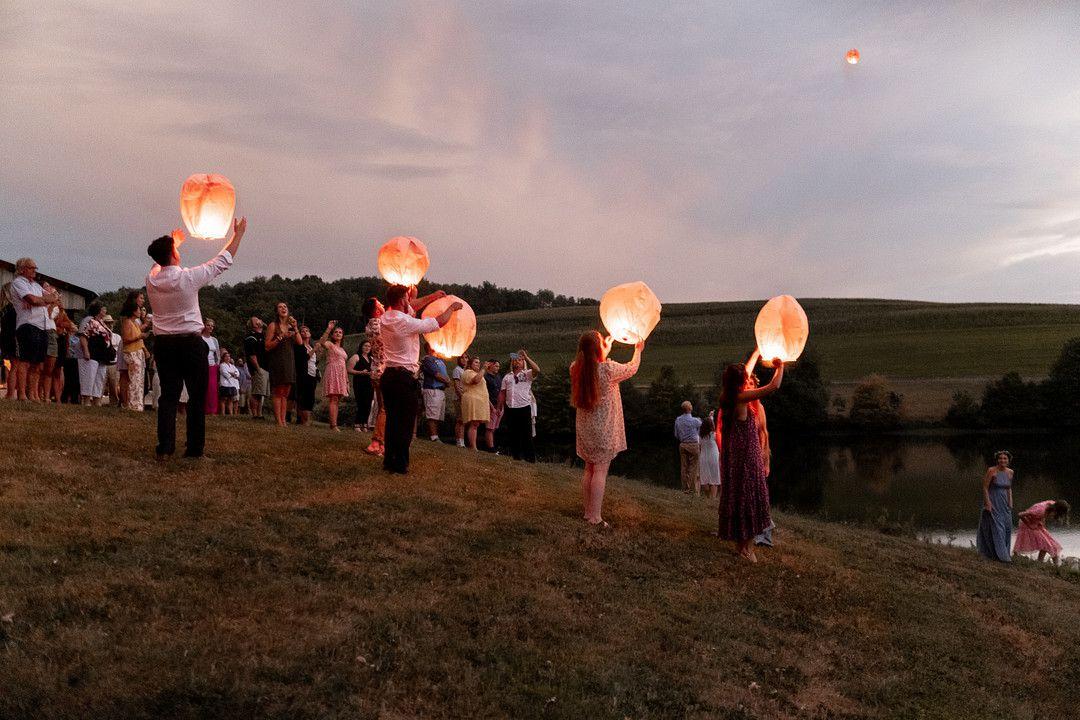 wedding guests releasing lanterns