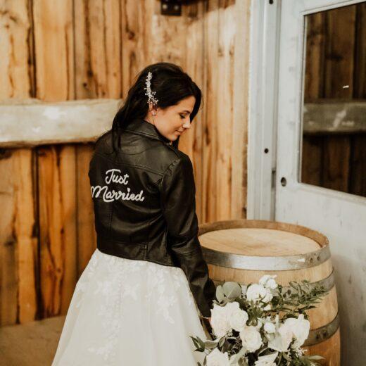 bride wearing bridal jacket